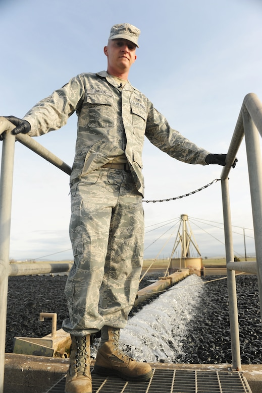 Staff Sgt. Paul Bauer, 9th Civil Engineer Squadron water and fuels system maintenance journeyman, oversees the trickling filter, which is used as a bio-filtration system, at the waste water facility on Beale Air Force Base, Calif., March 5, 2013.  The facility safely treats the waste water on Beale and provides clean drinking water. (U.S. Air Force photo by Airman 1st Class Bobby Cummings/Released)