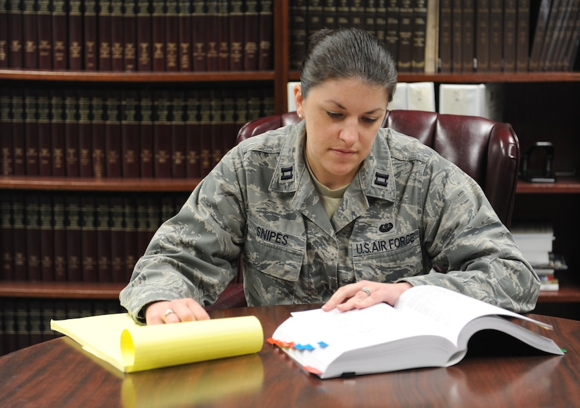 Capt. Amanda Snipes, 375th Air Mobility Wing general law chief and special victims' counsel, conducts research on sexual offense cases at Scott AFB March 1.  As an SVC, her job is to provide sexual assault victims with guidance and legal representation throughout the criminal proceeding.  (U.S. Air Force photo/Staff Sgt. Maria Bowman)
