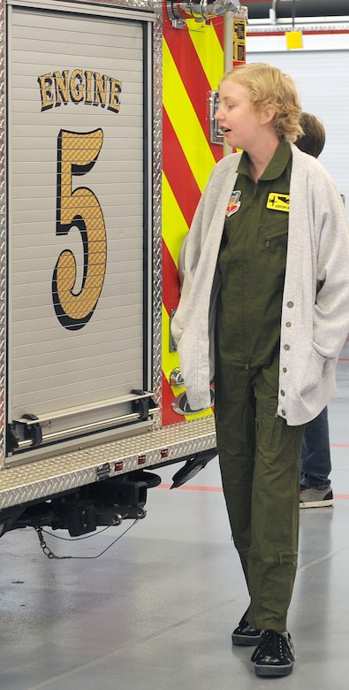 Addison Rerecich, a 13-year-old Tucsonan recovering from a double lung transplant, walks past a fire engine at the fire station during her tour of Davis-Monthan Air Force Base, Ariz. Feb. 21, 2013, as the Pilot for a Day participant. The Pilot for a Day program strives to give each child a special day and a break from the challenges they may face. (U.S. Air Force photo by Senior Airman Brittany Dowdle)