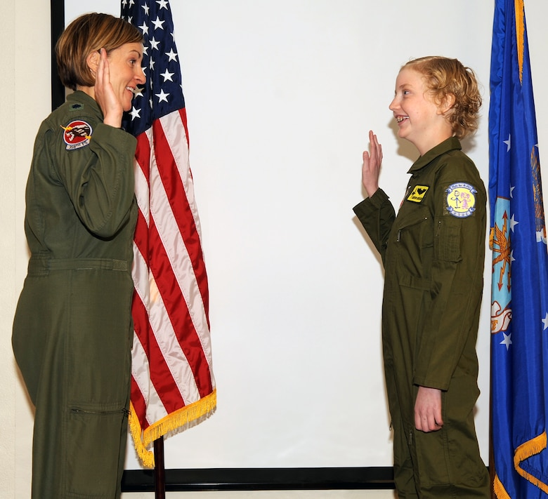 "U.S. Air Force Lt. Col. Jennifer Short, 358th Fighter Squadron commander, swears in Addison Rerecich, a 13-year-old Tucsonan recovering from a double lung transplant, as part of the Pilot for a Day program at Davis-Monthan Air Force Base, Ariz. Feb. 21, 2013. The Pilot for a Day program begins with a brief ""swearing in"" ceremony at the host flying squadron, after which the child becomes an ""honorary United States Air Force pilot"". (U.S. Air Force photo by Senior Airman Brittany Dowdle)"