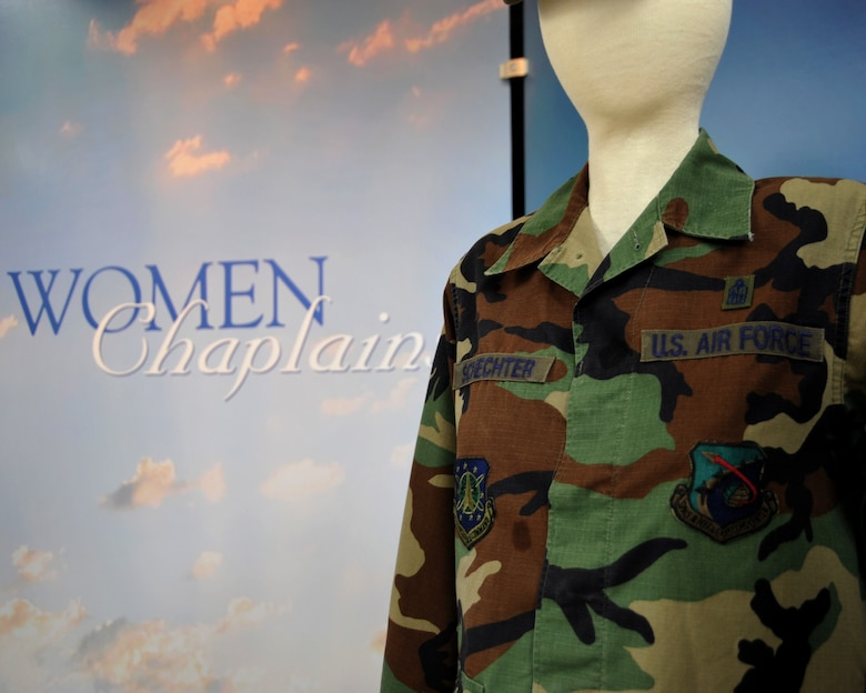 "A maternity battle dress uniform, donated by Chaplain (Capt.) Sarah Schechter, is displayed at the Women In Military Service For America Memorial in Arlington, Va., March 4, 2013. The uniform is part of the new exhibit celebrating 40 Years of women chaplains titled,  ""A Courageous Journey of Faith and Service."" Schechter is the first and only female rabbi in the Air Force. (U.S. Air Force photo/Airman 1st Class Alexander W. Riedel)"
