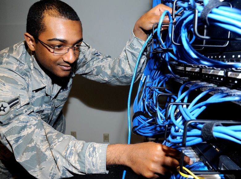 Airman 1st Class Rafeal Beckwith, a client systems technician with the 71st Communications Squadron, inspects the switchboard in Building 246 at Vance Air Force Base, Okla. Beckwith was named the 71st Flying Training Wing Airman of the Month for February. (U.S. Air Force photo/ Airman 1st Class Frank Casciotta)