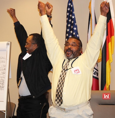 Carlos Clarke (left) and Robert Meekie, Contracting Division, celebrate their victory as 2013 Brain Brawl champions. Photo by Christina Swanson.