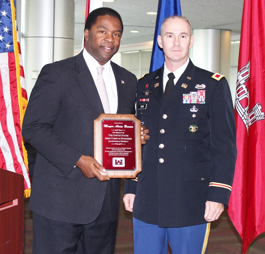 Col. Alan Dodd (right), district commander, presented a plaque to Jacksonville Mayor Alvin Brown to thank him for his participation in the Black History Month closing ceremony Feb. 27. Brown is the first African American mayor of Jacksonville, and has made military affairs a priority for his administration.