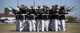 """The Marine Corps Silent Drill Platoon executes its """"bursting bomb"""" formation during a Battle Color Detachment ceremony at Marine Corps Air Station Yuma, Ariz., March 1, 2012. The Battle Color Detachment, composed by silent drill platoon, the U.S. Marine Drum and Bugle Corps and Marine Corps Color Guard, is currently on its national installation tour."""