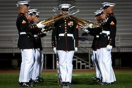 The Marine Corps Silent Drill Platoon performs during Battle Color Detachment ceremony at Veterans Memorial Stadium, Yuma, Ariz., March 2, 2012. The Battle Color Detachment, composed by the Silent Drill Platoon, the U.S. Marine Drum and Bugle Corps and Marine Corps Color Guard, is currently on its national installations tour.
