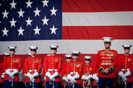 The U.S. Marine Drum & Bugle Corps and Maj. Brian J. Dix, the D&B director, stand on stage after a performance during the Semper Fidelis Society of Boston's 237th Marine Corps Birthday celebration at the Boston Convention and Exhibition Center Nov.9.