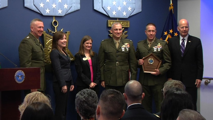Lt. Gen. Steven A. Hummer, commander of Marine Forces Reserve and Marine Forces North, Shanon C. Neal, MARFORRES family readiness officer, Sarah Lauten, 4th Marine Division family readiness officer, Col. Christopher Starling, commanding officer of 23rd Marine Regiment, and Lt. Col. Kevin H. Hutchison, inspector-instructor for 2/23, accept the 2012 Department of Defense Reserve Family Readiness Award presented by retired Navy Vice Adm. Norb R.Ryan Jr., the president of Military Officers Association of America, at the Pentagon, March 1.