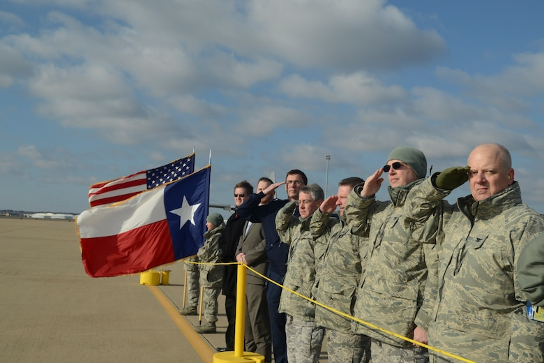 Texas State Legislative Representatives and Airmen of the 136th Airlift Wing salute the departing C-130 aircraft carrying the deploying Airmen to Southwest Asia at NAS Fort Worth JRB, Texas, Feb. 26, 2013. The Airmen will support the Air Expeditionary Forces in Southwest Asia from 60 to 180 days. (National Guard photos by Senior Master Sgt. Elizabeth Gilbert)