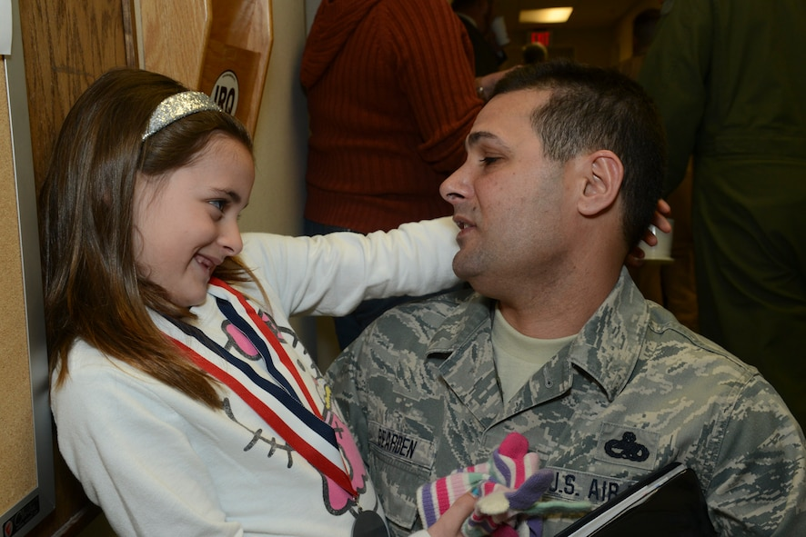 Senior Master Sgt. Shawn Bearden, First Sgt., 136th Airlift Wing and his daughter spend quality time together prior to his departure for Southwest Asia at NAS Fort Worth JRB, Texas, Feb. 26, 2013. The Airmen will support the Air Expeditionary Forces in Southwest Asia from 60 to 180 days. (National Guard photos by Senior Master Sgt. Elizabeth Gilbert)