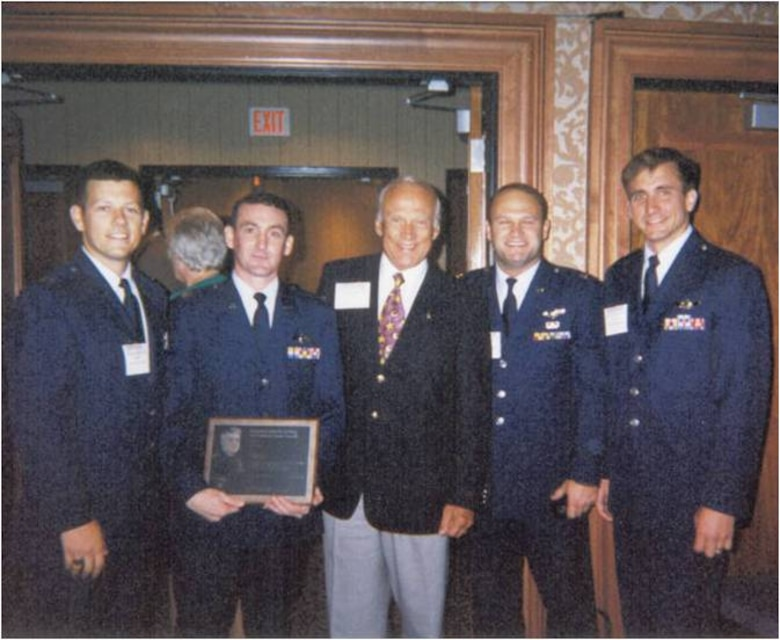 "(From left to right) Capt. John Martin, Capt. Randy Kaufman, Apollo astronaut Buzz Aldrin, Capt. Joe Reidy and Capt. Jeffrey Taliaferro gather after winning the Lemay Award for their work during Operation Desert Fox at the Air Force Association banquet in Washington, D.C., September 1999. The four captains manned the B-1 bomber codenamed ""Slam 4"" and were recognized for being the most outstanding aircrew in the Air Force. (U.S. Air Force courtesy photo/Released)"