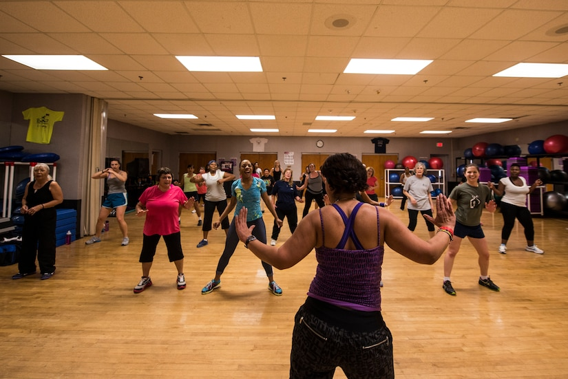Elaine Domenech, Zumba instructor, demonstrates dance movies during a Zumba class Feb. 27, 2013, at the Joint Base Charleston - Air Base Fitness Center. Zumba involves dance and aerobic elements, incorporating Hip-hop, Soca, Samba, Salsa, Merengue, Mambo, martial arts, and some Bollywood and belly dance moves. The Zumba classes are held 4:35 to 5:35 p.m. on Mondays; noon to 1 p.m. on Tuesdays; 11 to 11:50 a.m. and 4:35 to 5:35 p.m. on Wednesdays; noon to 1 p.m. and 7 to 8 p.m. on Thursdays; 4:35 to 5:35 p.m. on Fridays and 9:30 to 10:30 a.m. on Saturdays. (U.S. Air Force photo/ Senior Airman George Goslin)