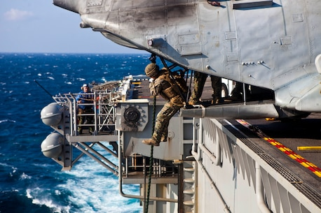 A Marine with the Maritime Raid Force, 31st Marine Expeditionary Unit, fast ropes out of a CH-46E Sea Knight helicopter during helicopter rope suspension techniques training here, March 7. The purpose of the fast rope insertion is to deploy Marines and Sailors in a situation where a helicopter cannot land. The 31st MEU maintains the fast rope capability for use in numerous contingencies from combat insertions to humanitarian operations.   The 31st MEU is the only continuously forward-deployed MEU and is the Marine Corps' force in readiness in the Asia-Pacific region.