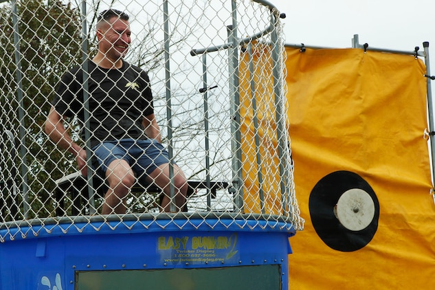 Lt. Col. Stephen Acosta, Headquarters and Headquarters Squadron commanding officer, prepares to be dropped in a dunk tank at a unit fundraising event at the squadron headquarters, Feb. 27. The 2013 H&HS Marine Corps Ball will be held at the Hilton Head Marriott Resort and Spa in November.