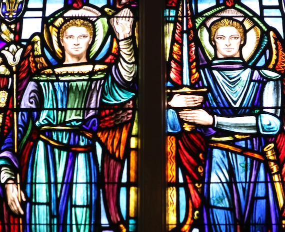 St. Joan of Arc, St. Gabriel and St. Michael along with a host of other saints adorn the windows of St. Francis Xavier Catholic Chapel aboard Marine Corps Base Camp Lejeune. The stained-glass windows were paid for with contributions of Marines world-wide and were given to the church in 1948. They are dedicated to Marines and sailors who served in various units throughout World War II.