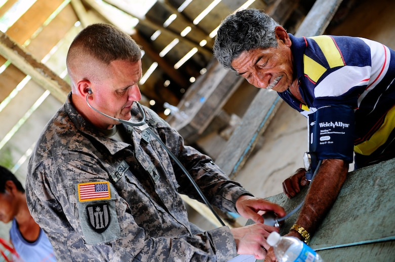 U.S. Army Sgt. Christopher Fussell, medical element medic, checks the blood pressure of a patient during a Medical Readiness Training Exercise in Marraganti, Panama March 1, 2013. Joint Task Force-Bravo partnered with the Panama Ministry of Health, Panama Ministry of Education and Servicio Nacional de Fronteras to exercise their expeditionary medical and mission command capabilities in preparation for future disaster relief events. (U.S. Air Force photo by Capt. Rebecca Heyse)