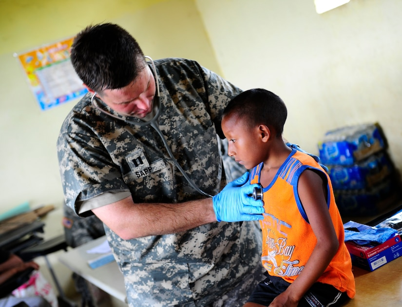 U.S. Army Capt. Andre Sapp, medical element physician's assistant, examines a resident of Uala, Panama Feb. 27, 2013. Joint Task Force-Bravo partnered with Panamanian government organizations to bring general medical and dental care as part of a Medical Readiness Training Exercise. MEDRETEs allow JTF-Bravo to exercise their expeditionary medical and mission control capabilities in preparation for future disaster relief events while supporting regional governments efforts to bring medical care to their populations. (U.S. Air Force photo by Capt. Rebecca Heyse)