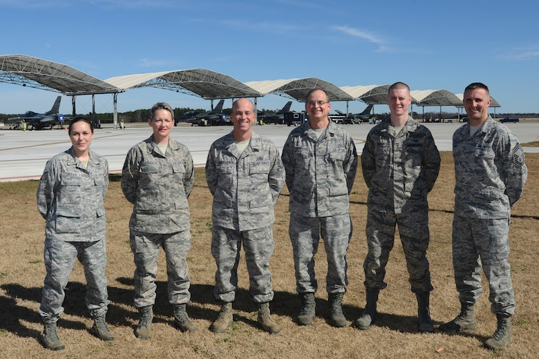 Airfield managers with the 169th Operations Support Flight at McEntire Joint National Guard Base, S.C., pose for a photo at the flight line, Feb. 20, 2013. The group was awarded the Airfield Operations Flight Complex of the Year. (National Guard photo by Tech. Sgt. Caycee Watson/Released)