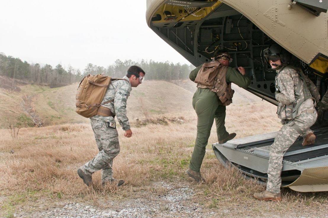 Alabama Air National Guard members from the 117th Air Refueling Wing arrive in a remote area to participate in a Survival, Evasion, Resistance and Escape (SERE) exercise. The purpose of the training is for pilots, boom operators and crew chiefs to know what to do if their aircraft goes down behind enemy lines. (U.S. Air Force photo by Master Sgt. David Maxwell)