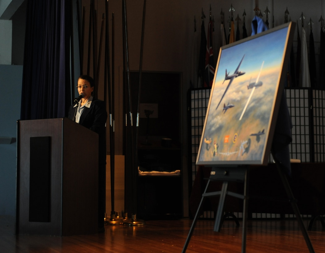 Aviation artist Kristin Hill speaks about her painting depicting the centennial of the 1st Reconnaissance Squadron at Beale Air Force Base, Calif., March 7, 2013. Hill has painted more than 250 aviation art paintings and has work featured in many international airports as well as the Pentagon. (U.S. Air Force photo by Staff Sgt. Robert M. Trujillo/Released)