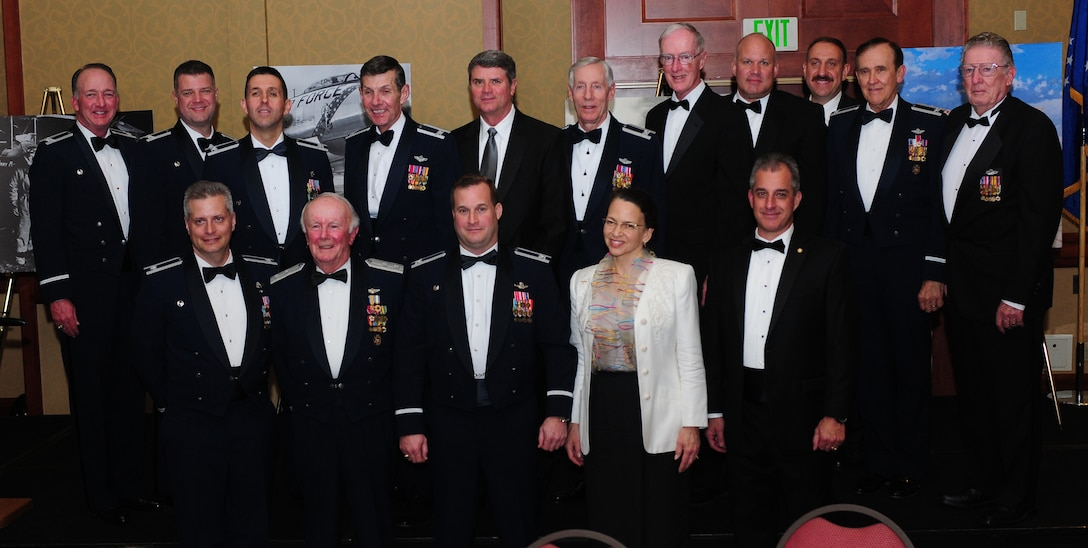 Col. Phil Stewart (lower middle), 9th Reconnaissance Wing commander, and 1st Reconnaissance Squadron past and present commanders pose for a photo during the 1st RS Centennial Celebration at the Sheraton Grand Hotel in Sacramento, Calif., March 9, 2013. Photos were on display showing the evolution of the squadron throughout the last 100 years. (U.S. Air Force photo by Senior Airman Allen Pollard/Released)