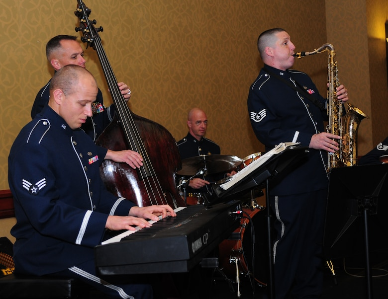 Members of the Air Force Band of Golden West play during the 1st Reconnaissance Squadron Centennial Celebration at the Sheraton Grand Hotel in Sacramento, Calif., March 9, 2013. The event was attended by current and past 1st RS commanders and members of Team Beale. (U.S. Air Force photo by Senior Airman Allen Pollard/Released)