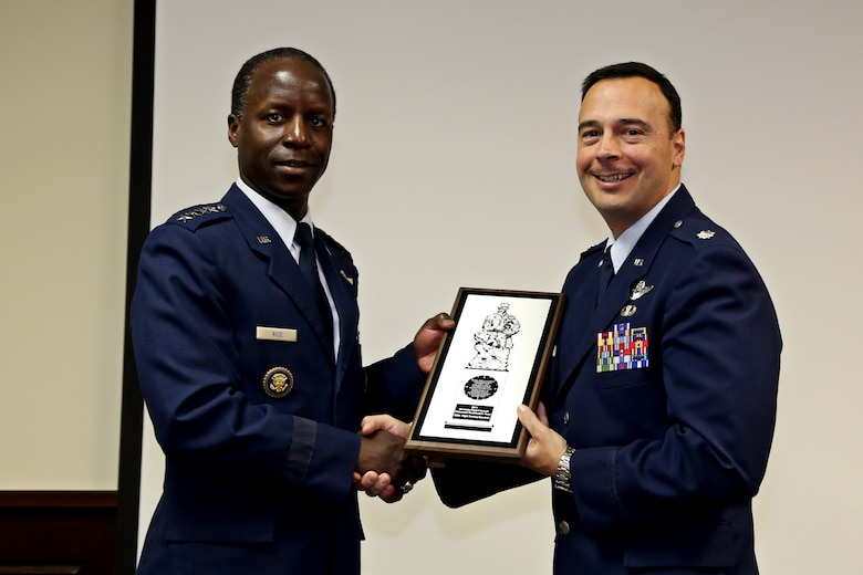 Gen. Edward Rice Jr., Commander of Air Education and Training Command, presents the 2011 Col. Joseph B. Duckworth Annual USAF Instrument award to Lt. Col. Scott Cerone, 558th Flying Training Squadron commander, at Joint Base San Antonio-Randolph, Texas March 8, 2013.  The 558th FTS' remotely piloted aircraft instrument qualification team earned the award for their efforts in developing the first pilot instrument qualification course for RPA operations. The program leverages existing joint primary pilot training courseware and extensive use of simulators.  (U.S. Air Force Photo by Josh Rodriguez)