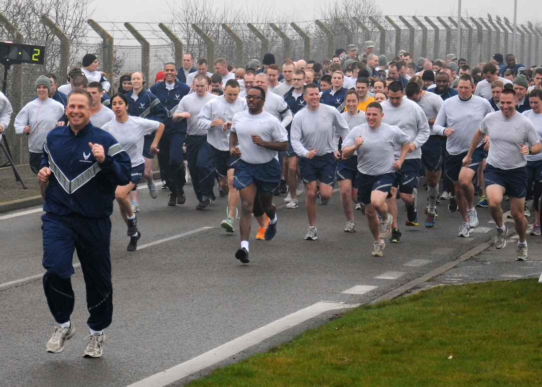 Col. Kyle Voigt, 100th Air Refueling Wing vice commander, leads his Airmen in improving their fitness during a wing run March 8, 2013, on Perimeter Road near the Hardstand Fitness Center on RAF Mildenhall, England. The run takes place on the first Friday of every month and is mandatory for all 100th Air Refueling Wing military personnel, but tenant units and base ID card holders 13-years and older are welcome to attend. (U.S. Air Force photo by Gina Randall/Released)