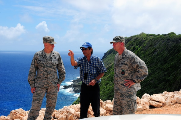 (Center) Gregg Ikehara, 36th Civil Engineer Squadron environmental restoration manager, explains the restoration details of Site 14 to (Left) Col. Donald Drechsler, 36th Wing vice commander and (Right) Lt. Col. Christopher Carter, 36th Civil Engineer Squadron commander. Site 14 was contaminated with harmful substances such as polychlorinated biphenyl and asbestos and is one of 80 sites Team Andersen is required to restore by 2014. (U.S. Air Force photo by Senior Airman Robert Hicks/Released)