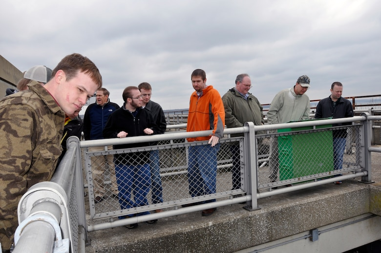 U.S. Army Corps of Engineer, Nashville District employee Jamie Holt, a power project specialist at the Lake Barkley power plant describes the procedures of hydropower generation to students and faculty from University of Tennessee at Martin Hydrology and Hydraulics class during a tour of the Lake Barkley lock and dam Feb. 28, 2013.  (USACE Photo by Mark Rankin)