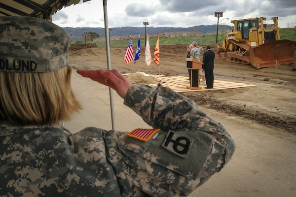 Chaplain (Capt.) Kerstin Hedlund salutes the flag during a groundbreaking ceremony March 6, 2013, at the U.S. Army Garrison Camp Parks Reserve training center in Dublin, Calif.