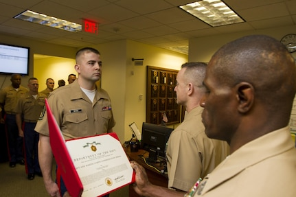 Gunnery Sgt. Josuha D. Boyer, Marine Corps Recruiting Station Pittsburgh Military Entrance Processing Station liaison, is presented with a Navy and Marine Corps Commendation Medal March 12 by Col. Jeffrey J. Dill, 1st Marine Corps District commanding officer, for earning the title of Marine Corps Recruiting Command, 1st Marine Corps District, Recruiting Substation staff noncommisioned officer of the year. Boyer earned the award, which included a replica model of the Iwo Jima flag raising, as the SNCOIC of RSS Butler throughout fiscal year 2012.