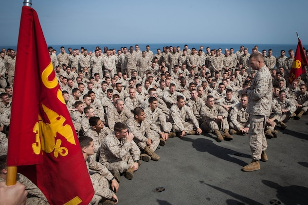 Lieutenant Col. Christeon Griffin, battalion commander, Battalion Landing Team 3/5, 15th Marine Expeditionary Unit, addresses his Marines after a Bronze Star pinning ceremony aboard USS Green Bay, March 3. Peterson received the award for his extraordinary guidance, zealous initiative and total dedication to duty while securing the historically violent and enemy controlled urban area of Wishtan and the surrounding region. The 15th MEU is deployed as part of the Peleliu Amphibious Ready Group as a U.S. Central Command theatre reserve force, providing support for maritime security operations and theatre security cooperation efforts in the U.S. 5th Fleet area of responsibility. (U.S. Marine Corps photo by Cpl. Bobby J. Gonzalez/Released)