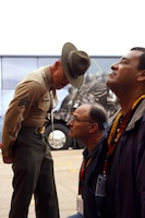 Sgt. Mark Reconsal corrects Mike Archer during a visit from the Marine Corps Executive Forum at the Marine Corps Recruit Depot San Diego March 7. Reconsal, a drill instructor with Support Battalion, Receiving Company, MCRD San Diego and Archer is the Museum of Flight Construction Coordinator in Seattle, Wash. and a member Marine Corps Executive Forum.