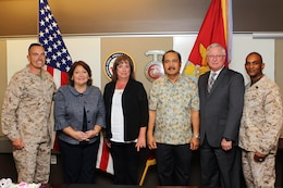 Brig. Gen. Vincent A. Coglianese and Sgt. Maj. Derrick Christovale Sr., flank Federal Length of Service awaard recipients, from left, Linda Teason, Judith Ramiro, Reynaldo Euperio, and Patrick Christman in the commanding general's conference room here March 12.