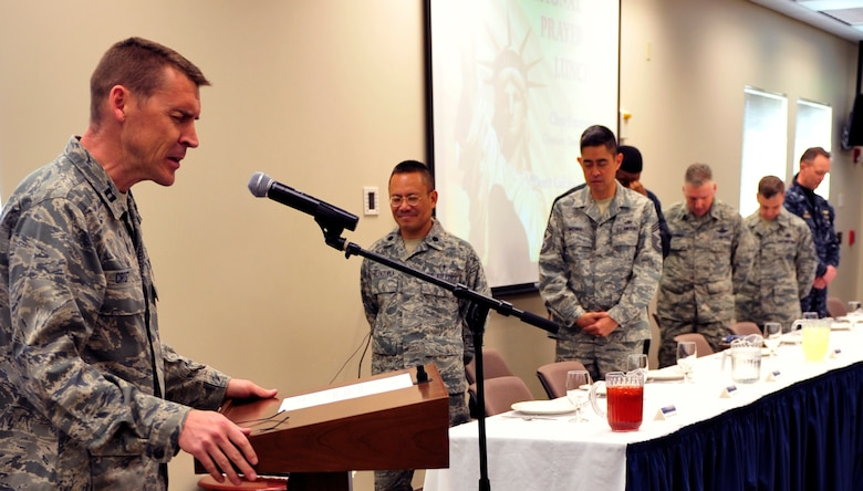 Chaplain (Capt.) Randy Croft, 460th Space Wing, gives the opening prayer and greetings during the National Prayer Luncheon March 6, 2013, at the chapel Fellowship Hall at Buckley Air Force Base, Colo. The luncheon was held to bring together the chapel community. (U.S. Air Force photo by Airman 1st Class Darryl Bolden Jr./Released)