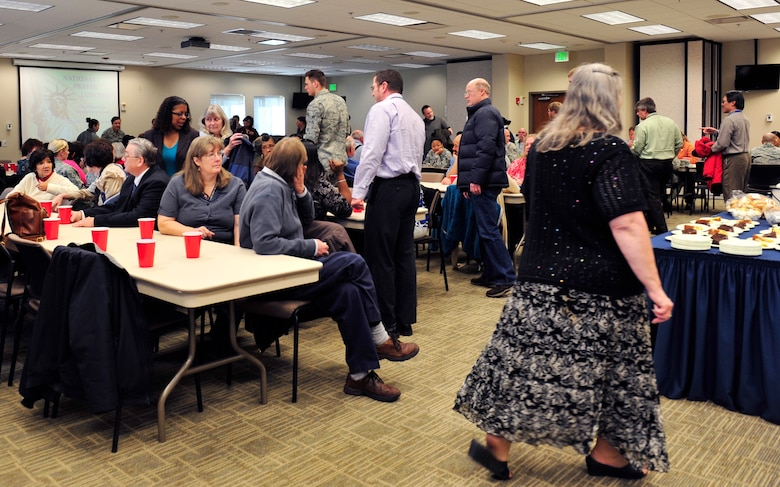 Participants of the annual National Prayer Luncheon meet and greet with one another before they share a meal March 6, 2013, at the chapel Fellowship Hall at Buckley Air Force Base, Colo. More than 220 military members and civilians fellowshipped, worshipped and feasted on food served by the chapel. (U.S. Air Force photo by Airman 1st Class Darryl Bolden Jr./Released)