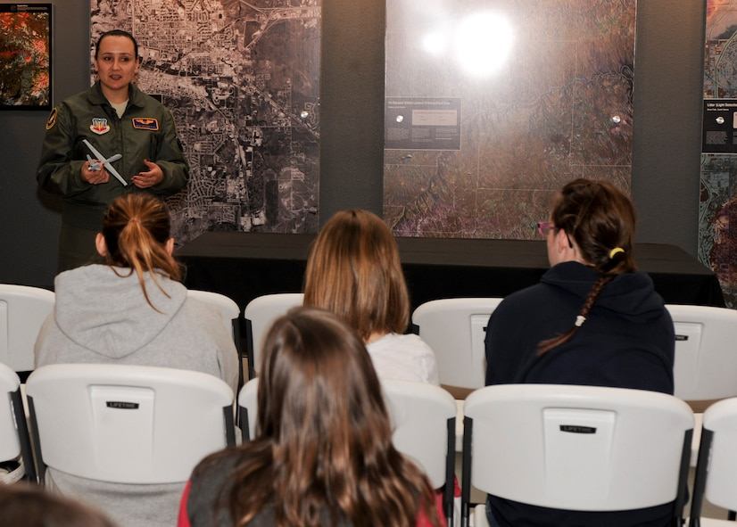 Master Sgt. Koleen Riggs, 432nd Attack Squadron sensor operator, speaks about her career during the Women of Aviation event at the South Dakota Air and Space Museum in Box Elder, S.D., March 9, 2013. Riggs has been an MQ-9 Reaper sensor operator for the last two and one half years, where she employs airborne to actively or passively acquire, track and monitor airborne, maritime and ground objects. (U.S. Air Force photo by Airman 1st Class Anania Tekurio/Released)