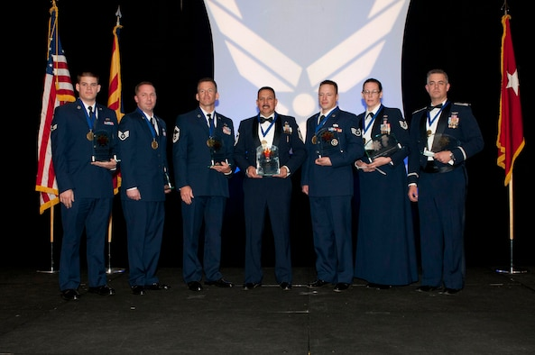 The 2012 Outstanding Airmen of the Year award recipients are, from left to right: Airman of the Year Senior Airman Russell Shirley, assigned to the 214th Air Reconnaissance Group; Noncommissioned Officer of the Year Staff Sgt. William Reid, assigned to the 107th Air Control Squadron; Senior Noncommissioned Officer of the Year Senior Master Sgt. David Juergens, assigned to the 162nd Fighter Wing; First Sergeant of the Year Senior Master Sgt. Marclen Polanco, assigned to the 162nd Fighter Wing; Honor Guard Member Staff Sgt. Ty Alan Goeken, assigned to the 162nd Fighter Wing; Command Chief Master Sergeant Award Tech. Sgt. Susan Koncz, assigned to the 161st Air Refueling Wing and the Major General Donald L. Owens Junior Officer of the Year Capt. Matthew S. Hodges, assigned to the 162nd Fighter Wing. (Air National Guard Photo by Tech. Sgt. Hollie Hansen)