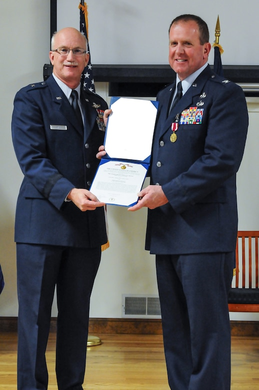 Col. Neil Mullaney (right), outgoing director of the Air Staff at Joint Forces Headquarters—Kentucky, receives a Meritorious Service Medal, third Oak Leaf Cluster, from Brig. Gen. Mark Kraus, Kentucky's assistant adjutant general for Air, during a retirement ceremony Feb. 2, 2013, at the Kentucky Air National Guard Base in Louisville, Ky. Mullaney participated in four conflicts and commanded multiple units during his 24-year career. (U.S. Air Force photo illustration by Senior Airman Vicky Spesard, Kentucky Air National Guard)