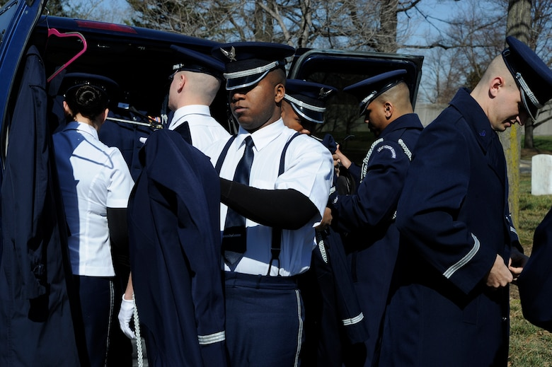 U.S. Air Force Honor Guard Body Bearers prepare for a funeral at Arlington National Cemetery March 4, 2013. The eight-person team is responsible for carrying the remains of deceased service members, their dependents, senior and national leaders to their final resting place at Arlington National Cemetery. (U.S Air Force photo by Staff Sgt. Christopher Ruano)
