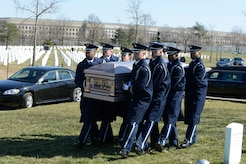 U.S. Air Force Honor Guard Body Bearers carry the casket of our fallen at Arlington National Cemetery March 4, 2013. The eight-person element is responsible for carrying the remains of deceased service members, their dependents, senior and national leaders to their final resting place at Arlington National Cemetery. (U.S Air Force photo by Staff Sgt. Christopher Ruano)