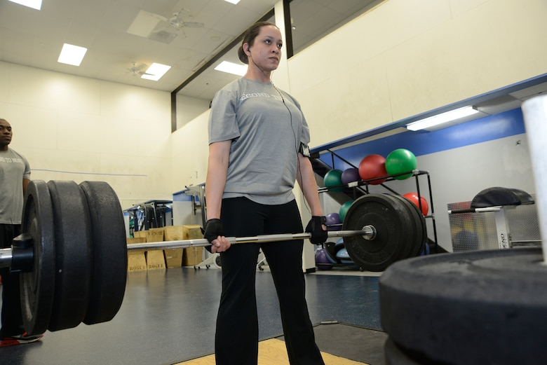 Staff Sgt. Jennifer Powell, United States Air Force Honor Guard pallbearer, performs a 280-pound deadlift to continue to meet the weightlifting requirements to be part of the Body Bearing team. As a pallbearer, Powell is part of an eight-person team responsible for carrying the remains of deceased service members, their dependents, senior or national leaders to their final resting place at Arlington National Cemetery. (U.S Air Force photo by Staff Sgt. Christopher Ruano)