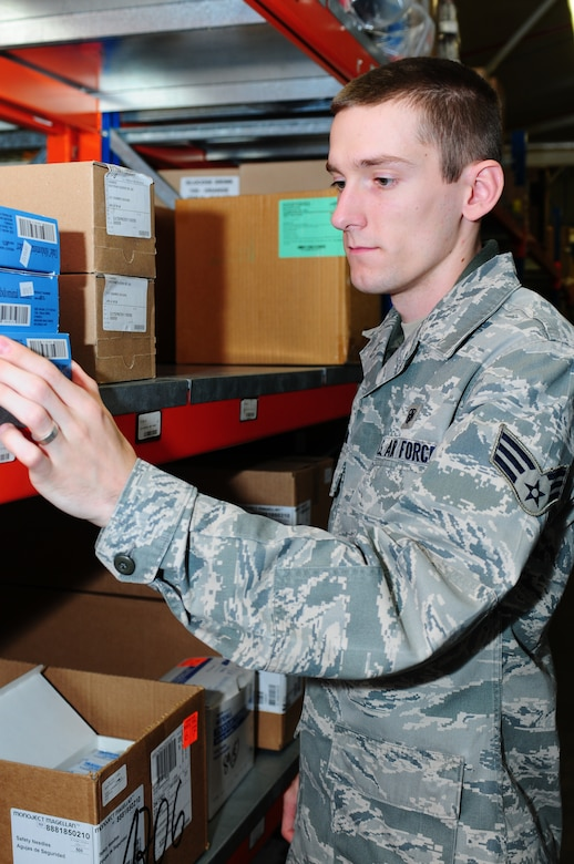 """Medical logistics technician displays """"Excellence in All We Do ..."""