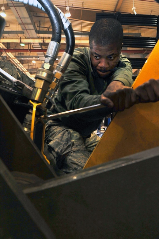 Airman 1st Class Benjamin George, 51st Logistics Readiness Squadron vehicle managment technician, tightens hydraulic fittings at the VM main shop at Osan Air Base, Republic of Korea, March 12, 2013. More than 80 mechanics work in the 84,000 square-foot facility. The main shop is uniquely consolidated in that it includes customer service, vehicle management and analysis, general purpose, special purpose and allied trades in the same building. (U.S. Air Force photo/Senior Airman Alexis Siekert)
