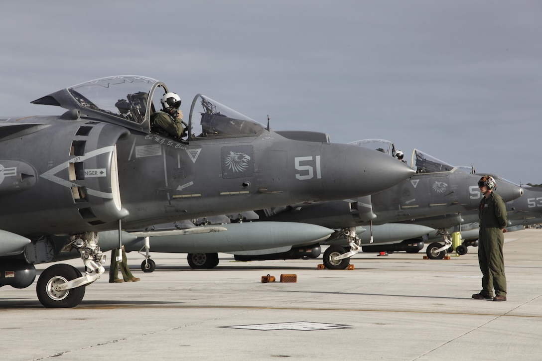 An AV-8B Harrier pilot with Marine Attack Squadron 231 sits in his aircraft and checks his equipment before departing Cherry Point March 11. Approximately 80 Marines and Sailors with VMA-231 departed Cherry Point to support operations with the 26th Marine Expeditionary Unit.