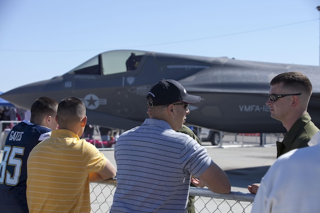 Pilots and aircraft maintainers of Marine Fighter Attack Squadron 121 inform attendees about the F-35B Lightning II during the 51st annual Marine Corps Air Station Yuma's Air Show, March 9.  The aircraft was put on display for everyone at the show to get a first-hand look at the new aircraft and learn about its unique capabilities.