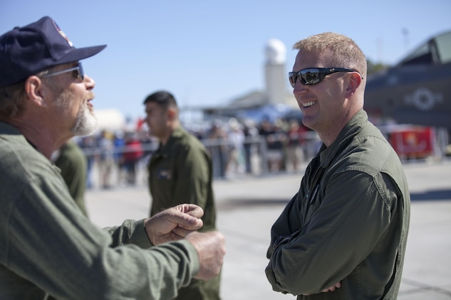 Maj. Michael Wyrsch, a Marine Fighter Attack Squadron 121 pilot and a native of Silver Spring, Md., answers questions in relation to the F-35B static display to an attendee at Marine Corps Air Station Yuma's Air Show, March 9.