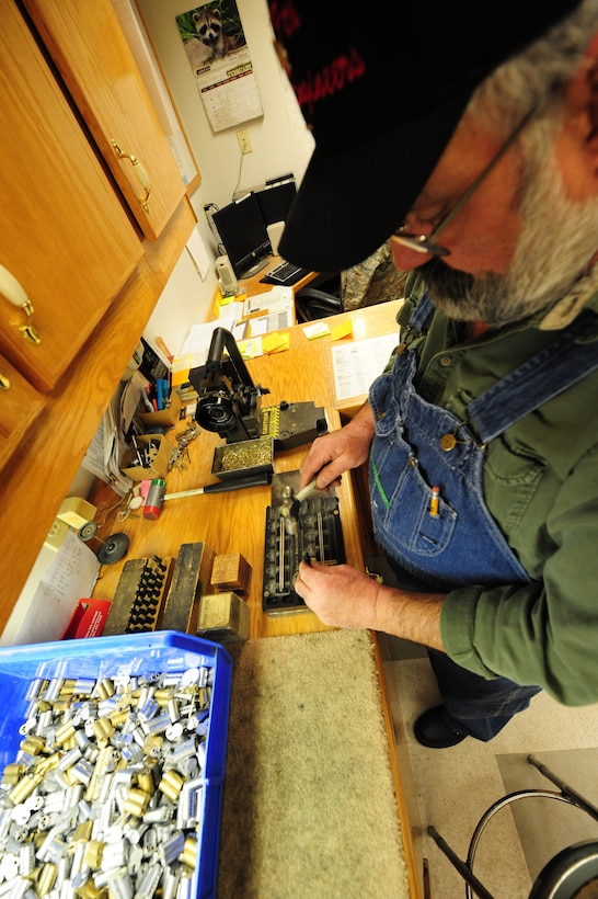 WHITEMAN AIR FORCE BASE, Mo. -- Jack Crain, 509th Civil Engineer Squadron locksmith, hammers pinning codes into a key, Mach 6. Different series of numbers help prevent the duplication of keys and maintain the continuity of locks. (U.S. Air Force photo/Staff Sgt. Nick Wilson) (Released)