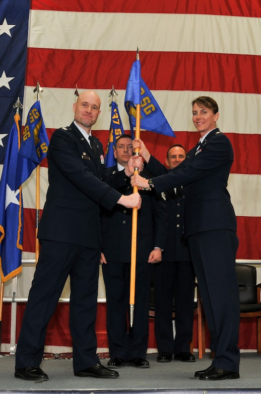 Air National Guard Col. Gregory T. White, 233d Space Group Commander, hands the 233d Logistics Readiness Flight flag to Maj. Shelley R. Atkinson, the newly appointed 233d Logistics Readiness Flight Commander, during the 233d Space Group Activation Ceremony, March 10, 2013, Greeley Air National Guard Station, Greeley, Colo.  The 137th Space Warning Squadron reorganized as the 233d Space Group and will continue to operate under the 140th Wing, performing the one-of-a-kind Mobile Ground System mission that these men and women have been doing since 1996. (Air National Guard photo by Tech. Sgt. Wolfram M. Stumpf)